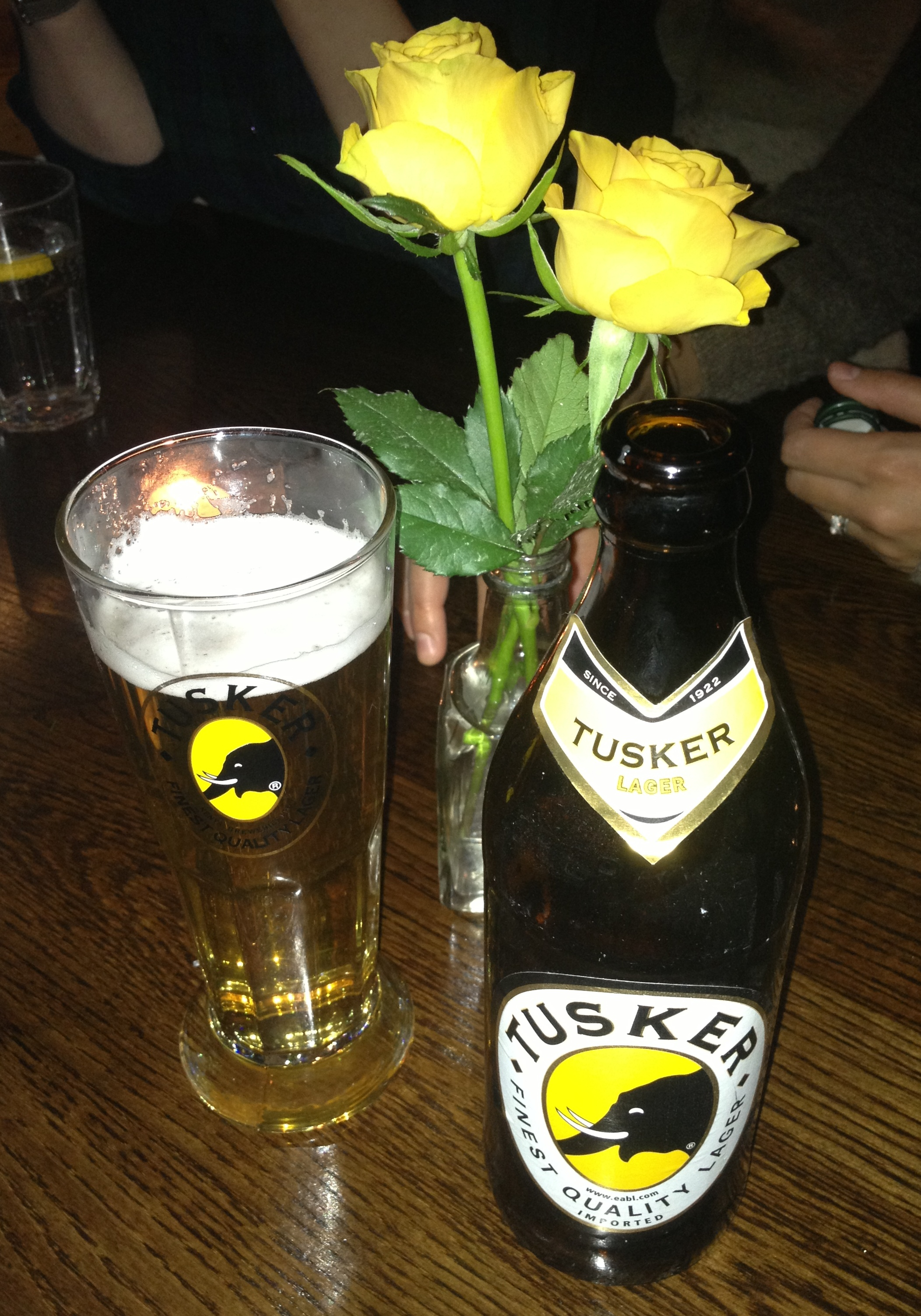 Adulis Tusker Lager and flowers - kenningtonrunoff.com