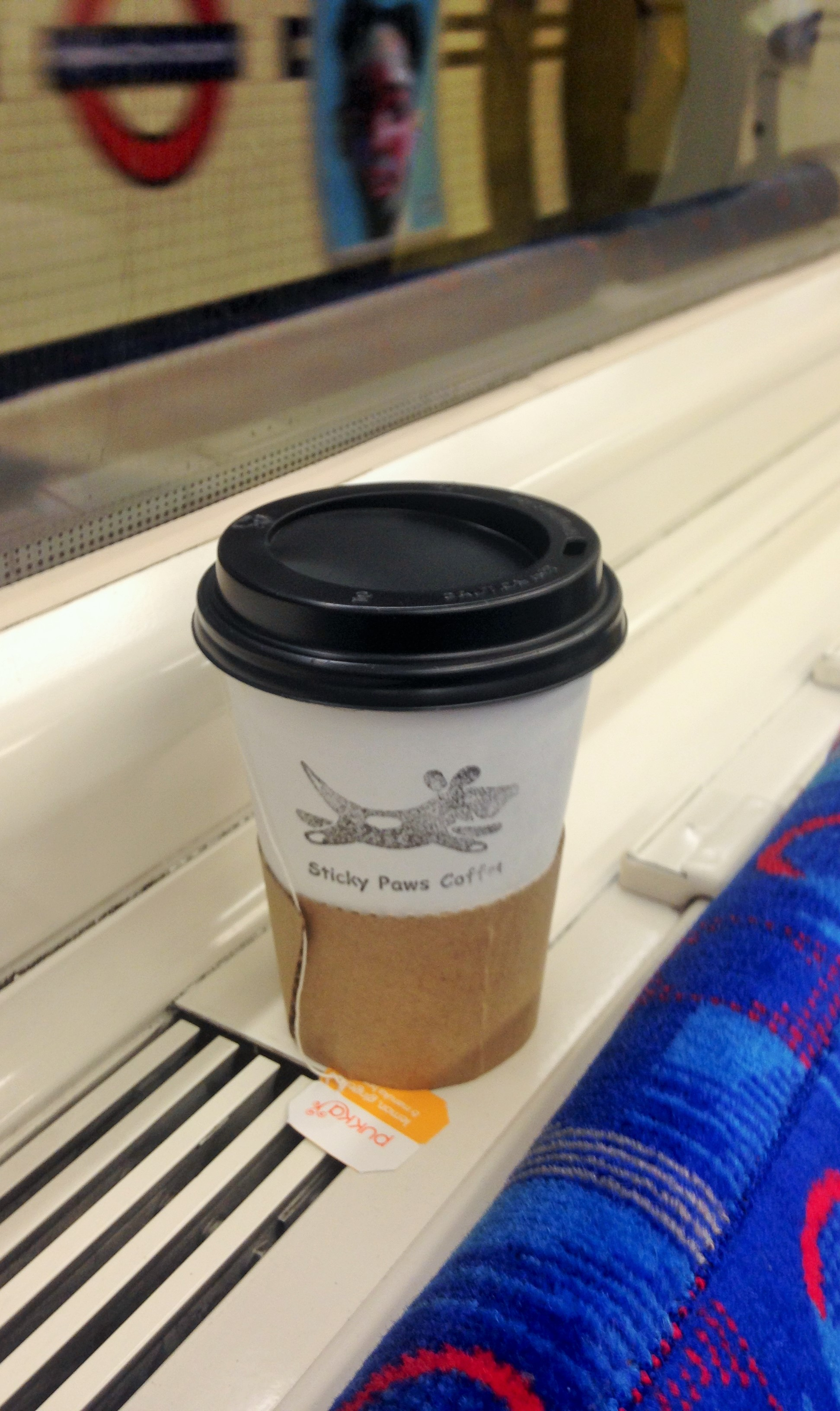 Sticky Paws Coffee cup on the Northern Line - kenningtonrunoff.com