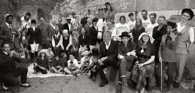 Earl of Bedlam staff, clients, models, friends & family by Jill Furmanovsky for Jocks & Nerds in Bedlam Mews with horses from Vauxhall City Farm, (Mark in the hat front right, Lady C next to him)