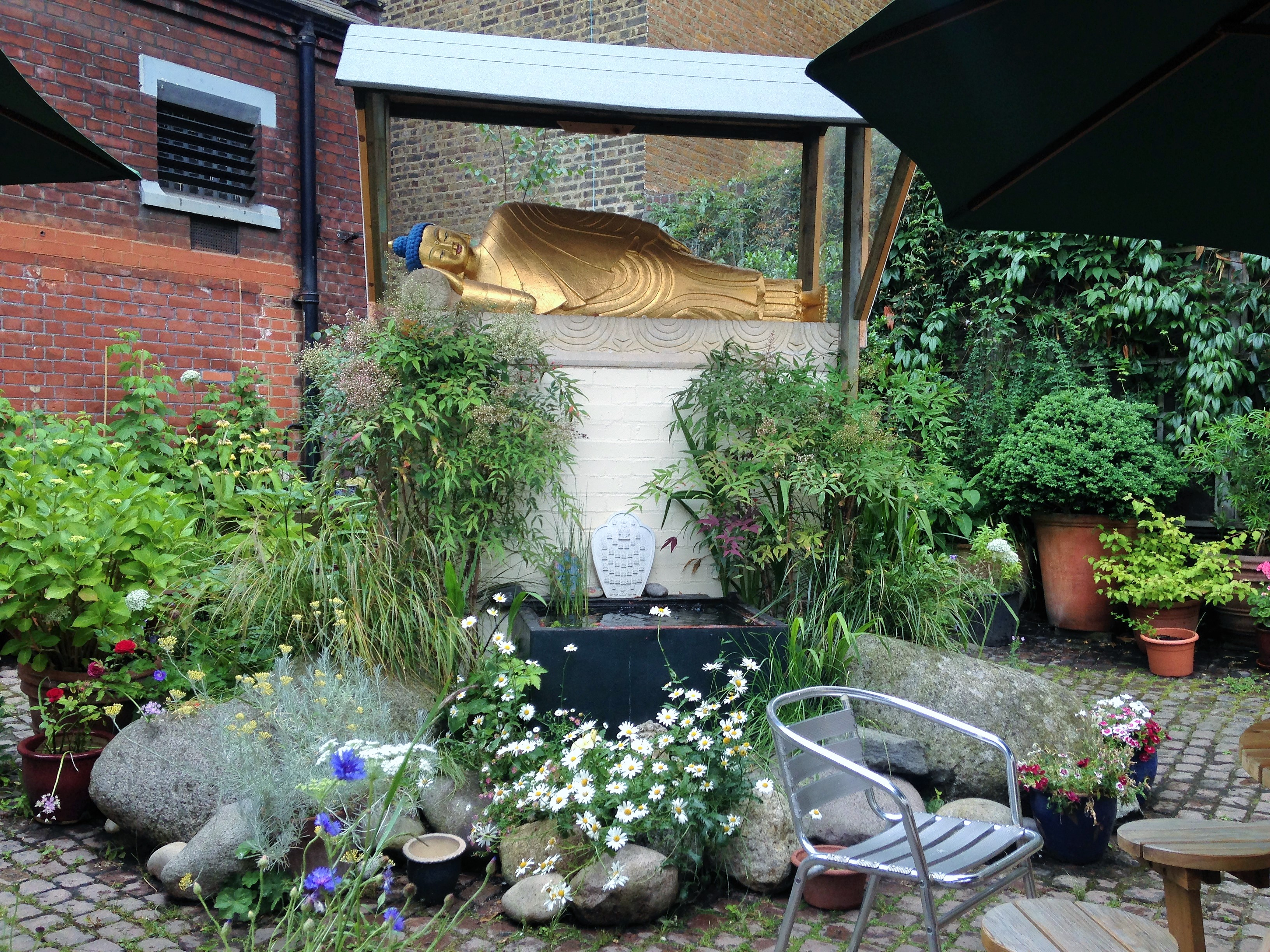 Golden Buddha in the courtyard of Jamyang Buddhist Centre - kenningtonrunoff.com