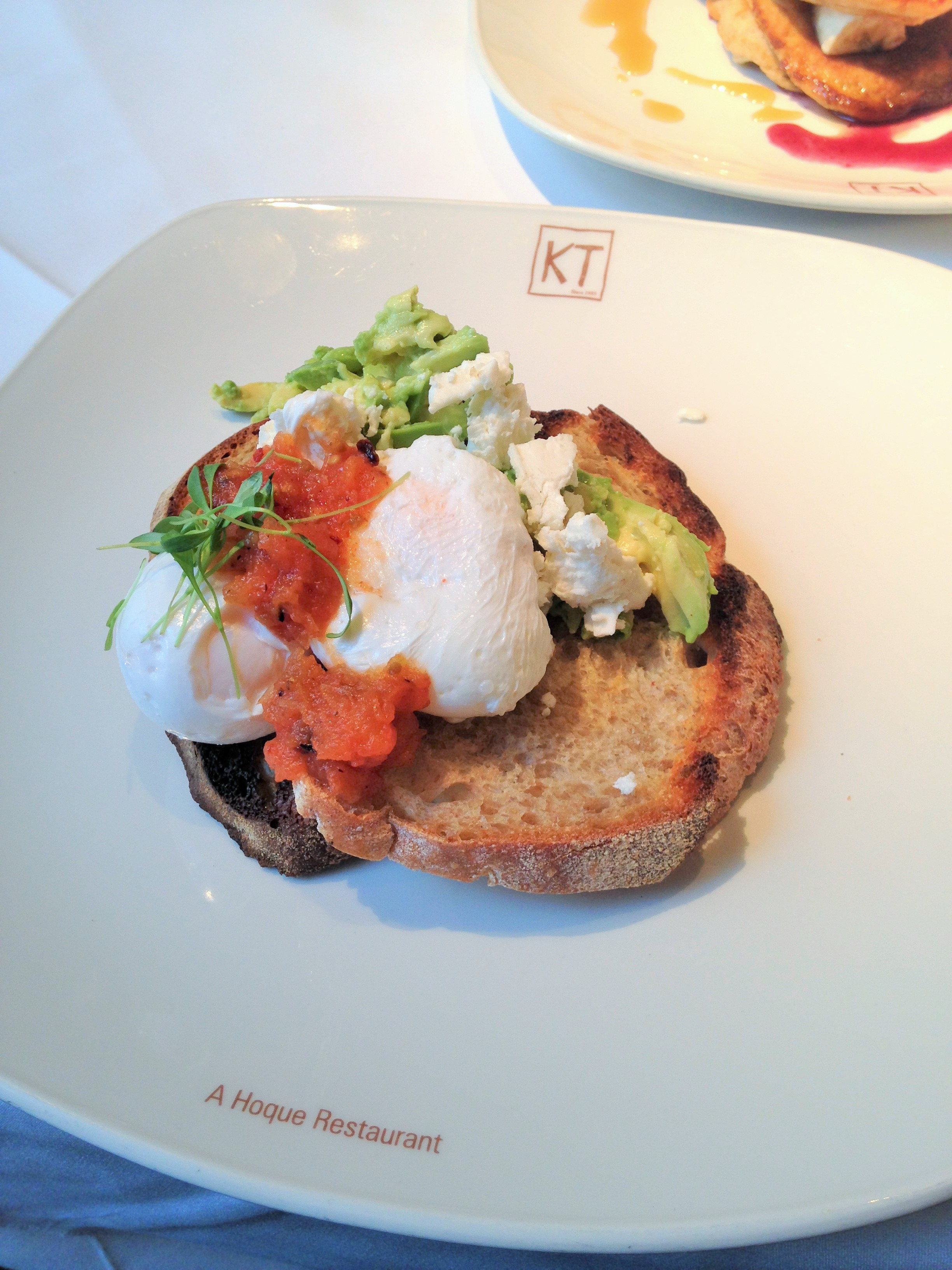 Kennington Tandoori avocado and sourdough toast with poached egg, feta cheese and KT tomato salsa - kenningtonunoff.com